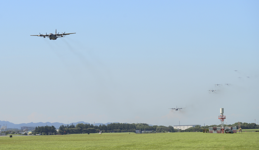 Multiple C-130 Hercules fly over the airfield during a training exercise at Yokota Air Base, Japan, July 14, 2015. Ten C-130s participated in the exercise which tested the 36th Airlift Squadron's ability to perform large formation flights. (U.S. Air Force photo by Senior Airman David Owsianka/Released)