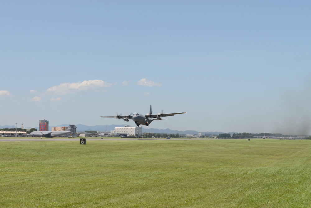 A C-130 Hercules takes to the sky as part of large formation training at Yokota Air Base, Japan, July 14, 2015. Nine C-130s took off as part of a surge mission highlighting Yokota's role as the primary airlift hub for the Indo-Asia Pacific Region. (U.S. Air Force photo by Airman 1st Class David C. Danford/Released)