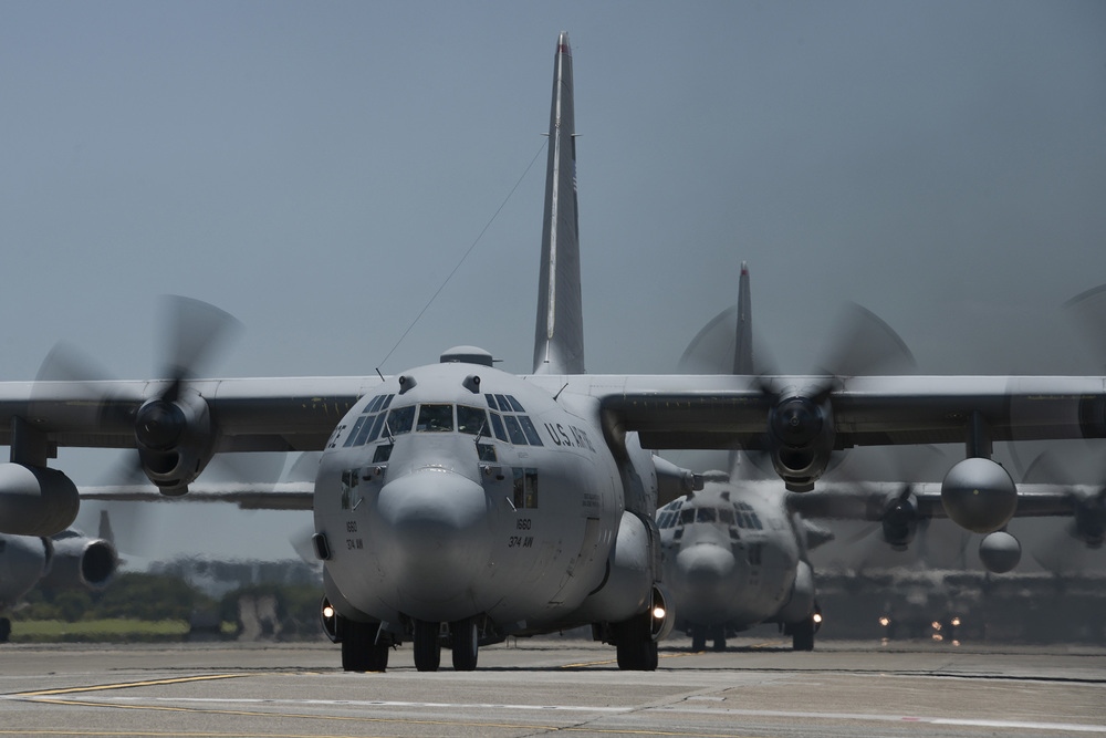 Multiple C-130 Hercules with the 374th Airlift Wing taxi during large formation training at Yokota Air Base, Japan, July 14, 2015. The training allowed aircrews an opportunity to practice their large formation and airlift capabilities. (U.S. Air Force photo by Staff Sgt. Cody H. Ramirez/Released)