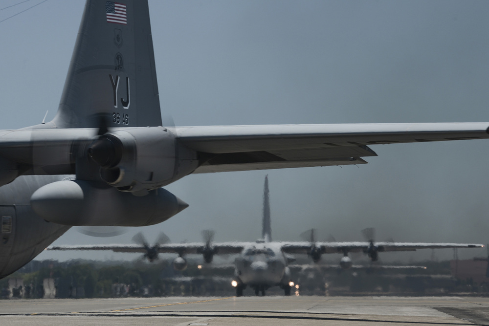 Multiple C-130 Hercules taxi during large formation training at Yokota Air Base, Japan, July 14, 2015. Yokota is the primary airlift hub in the Indo-Asia Pacific Region and the training allowed members to practice mission essential airlift capabilities. (U.S. Air Force photo by Staff Sgt. Cody H. Ramirez/Released)