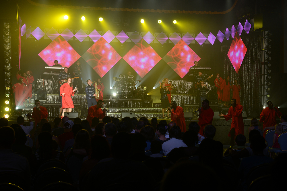 Singers with the Tops in Blue perform a gospel song during a show at Yokota Air Base, Japan, July 19, 2015. Tops in Blue provides entertainment to Air Force personnel stationed worldwide, including remote and deployed locations. (U.S. Air Force photo by Airman 1st Class David C. Danford/Released)