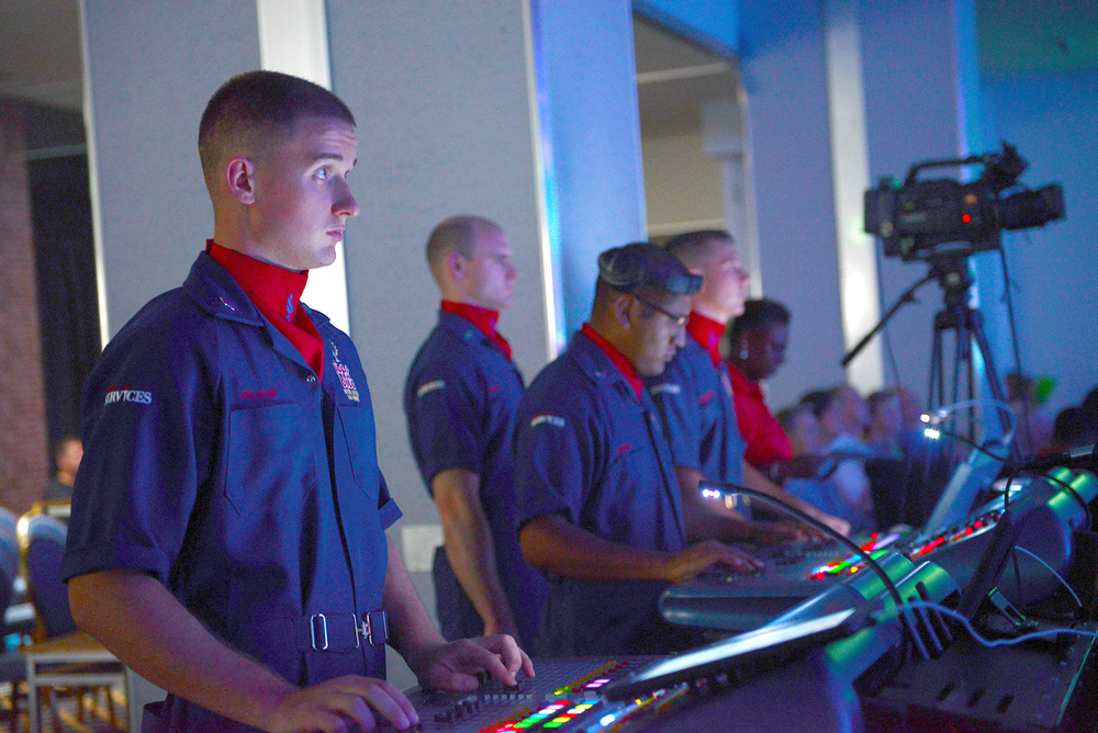Airmen with the Tops in Blue coordinate stage lighting during a show at Yokota Air Base, Japan, July 19, 2015. Tops in Blue, an Air Force performance ensemble, is a self-contained expeditionary entertainment unit consisting of four flights; personnel, logistics, operations and technical. (U.S. Air Force photo by Airman 1st Class David C. Danford/Released)