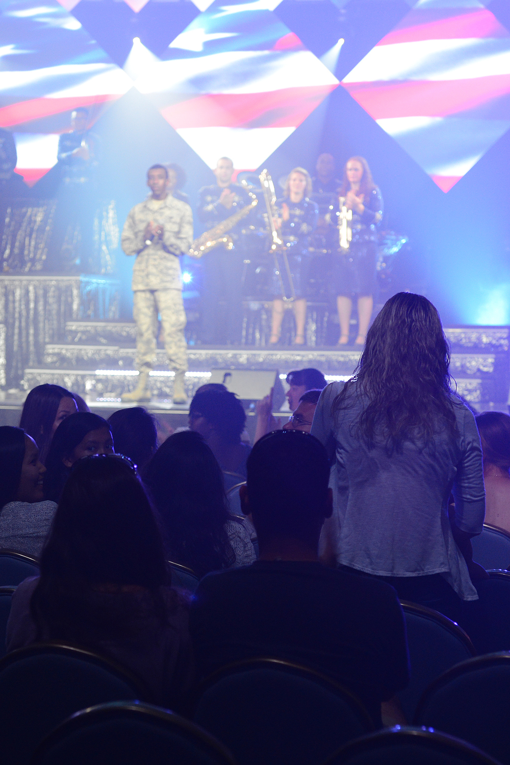 Staff Sgt. Brittany Masters, 374th Contracting Squadron contract specialist, is acknowledged for her contributions to Yokota Air Base and the local community during a Tops in Blue performance at Yokota AB, Japan, July 19, 2015. Tops in Blue provides entertainment to Air Force personnel stationed worldwide, including remote and deployed locations. (U.S. Air Force photo by Airman 1st Class David C. Danford/Released)