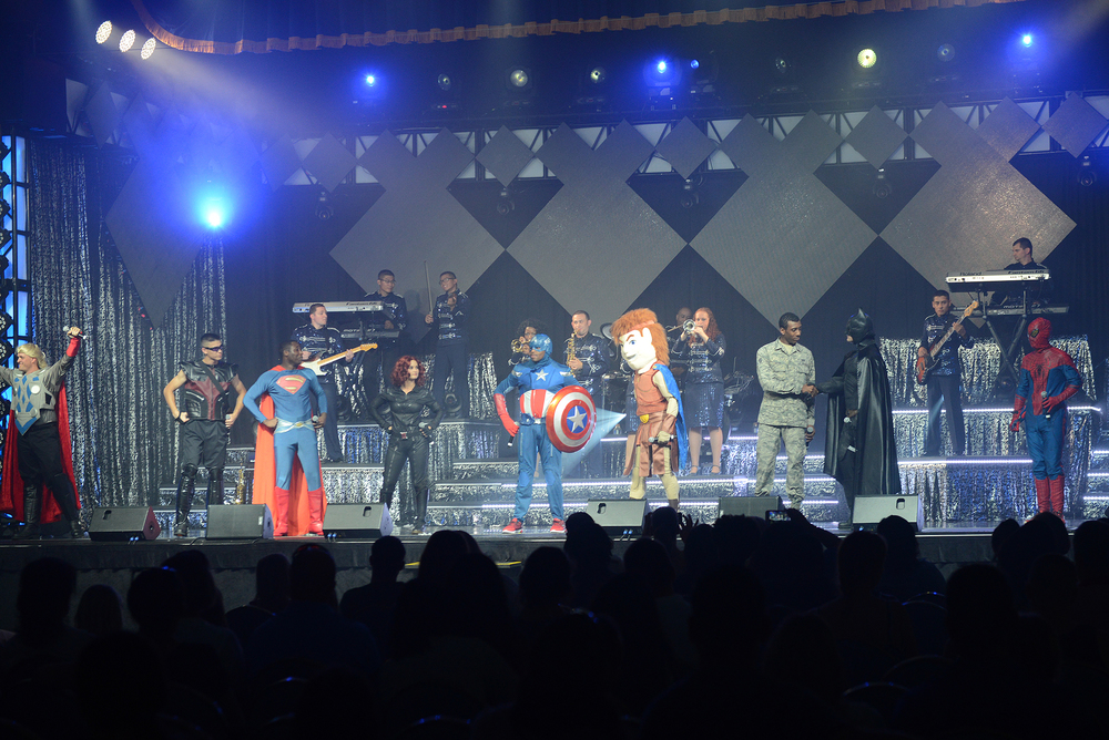 Members of the Tops in Blue dress as super heroes during their performance at Yokota Air Base, Japan, July 19, 2015. The show culminated in several songs paying tribute to U.S. service members. (U.S. Air Force photo by Airman 1st Class David C. Danford/Released)