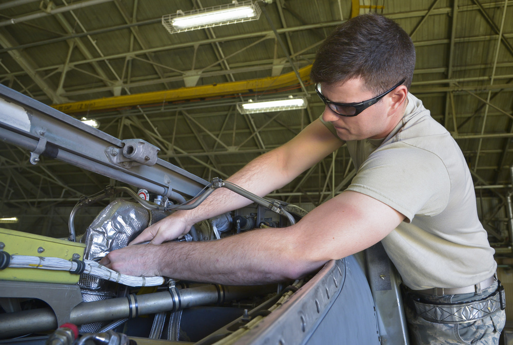 Airman Sam Johnson, 374th Maintenance Squadron propulsion flight aerospace propulsion apprentice, removes safety wires from a heat blanket inside a C-130 Hercules at Yokota Air Base, Japan, Sept. 23, 2015. After an engine or propeller is repaired by the flight, they will wait for the proper moment to be placed into action. (U.S. Air Force photo by Senior Airman David Owsianka/Released)