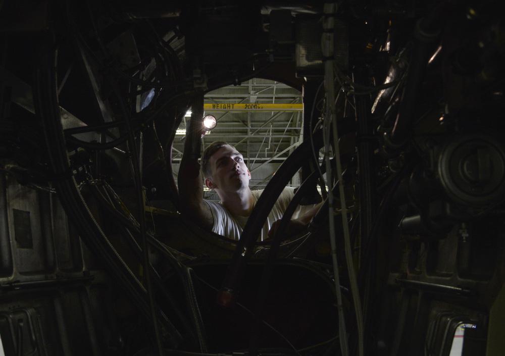 Senior Airman Devin Truesdell, 374th Maintenance Squadron propulsion flight aerospace propulsion journeyman, examines a quick engine change kit at Yokota Air Base, Japan, Sept. 23, 2015. The propulsion flight Airmen fix C-130 Hercules engines for both Yokota and Kadena Air Base. (U.S. Air Force photo by Senior Airman David Owsianka)