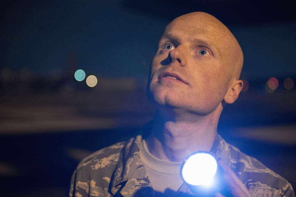 Airman 1st Class Christopher Cook, 374th Aircraft Maintenance Squadron crew chief, inspects a C-130 Hercules for obvious physical damage or leaks and to ensure all fasteners are sealed during VIGILANT ACE 16 at Yokota Air Base, Japan, Nov. 2, 2015. VIGILANT ACE is a U.S.-Republic of Korea combined exercise aimed at enhancing operational and tactical level coordination through combined and joint combat training. The exercise also provides critical training for the Airmen of the 374th Airlift Wing to maintain peace and stability in Japan and the entire Indo-Asia Pacific region. (U.S. Air Force photo by Staff Sgt. Cody H. Ramirez/Released)