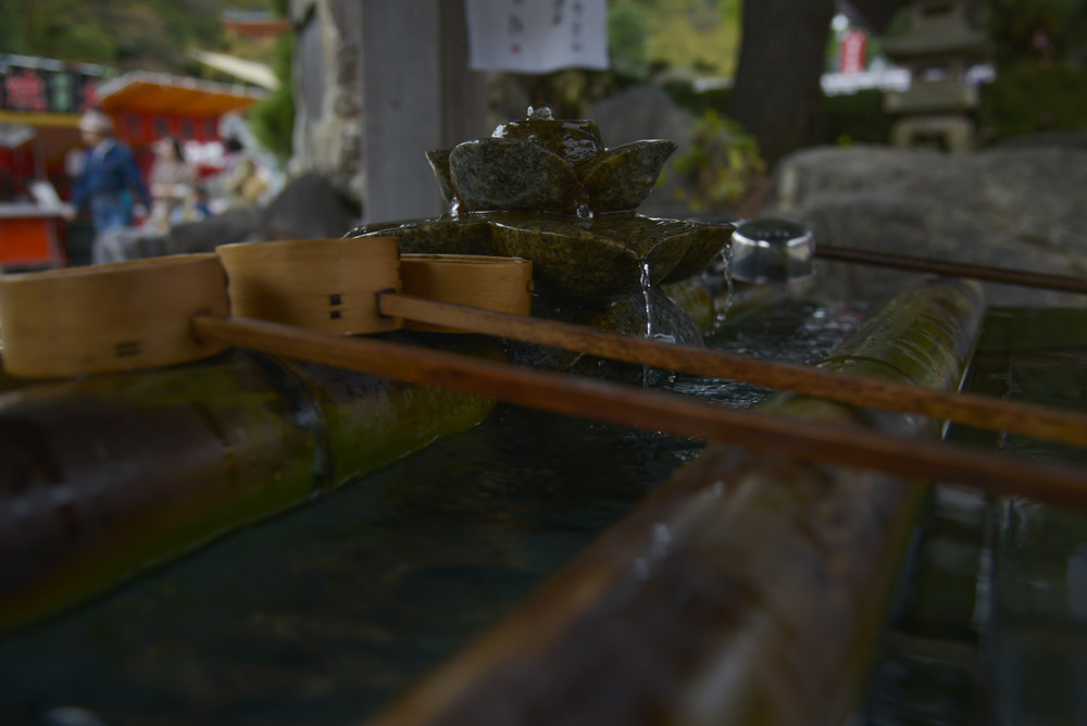 Water falls from a stone flower on top of a chuzo at the Takahata Fudo Temple grounds in Hino City, Japan, Nov. 1, 2015. Chozu's are used to purify a person's hands and mouth before they pray. (U.S. Air Force photo by Senior Airman David Owsianka/Released)