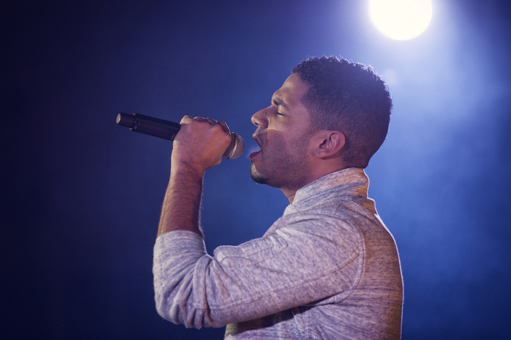 Jussie Smollett, known for his role as Jamal Lyon on the television series Empire, performs at Yokota Air Base, Japan, Dec. 15, 2015. As part of the United Service Organizations Empire tour, cast members participated in meet and greets, spoke with Yokota High School youth and hosted and performed a family-friendly White Party. Smollett said that the tour was a great opportunity for him to give back and share thanks to service members. (U.S. Air Force photo by Airman 1st Class Delano Scott/Released)