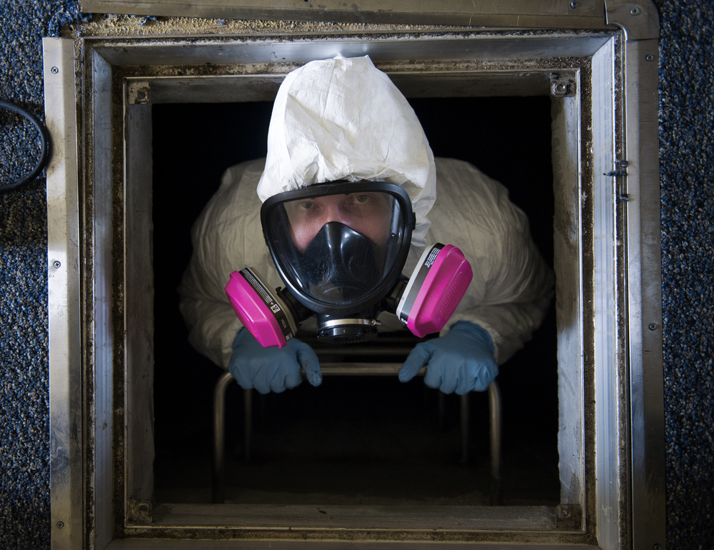 Staff Sgt. Brandon Cenarrusa, 374th Civil Engineer Squadron pest management craftsman, climbs out of the crawlspace of the Child Development Center at Yokota Air Base, Japan, Jan. 6, 2016. From performing disease vector surveillance to providing base wide pest control services for insects and wildlife, entomology Airmen utilize both preventative and immediate response maintenance practices to ensure that facilities remain pest free. (U.S. Air Force photo by Airman 1st Class Delano Scott/Released)