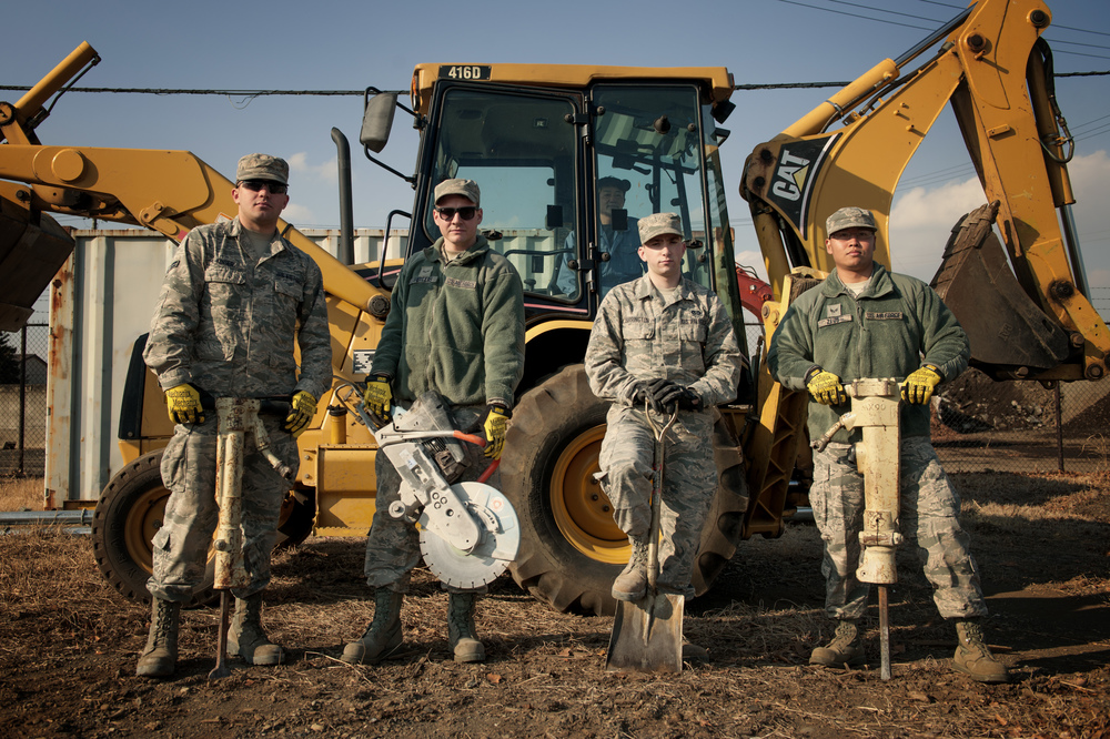 Members of the 374th Civil Engineer Squadron pavement and equipment shop pose for a photo, Jan. 13, 2016, at Yokota Air Base, Japan. From Keeping the flightline mission ready to maintaining the roads and sidewalks, the behind the scenes work done by the group of Airmen known as the 'Dirt Boys' keep Yokota's mission going. (U.S. Air Force photo by Airman 1st Class Delano Scott/Released)