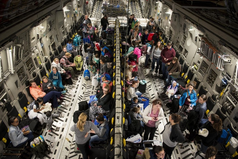Dependents of military members from Incirlik Air Base, Turkey, wait to disembark from a C-17 Globemaster III after landing at Baltimore-Washington International Airport, Md., April 1, 2016. Defense Department dependents in Adana, Izmir and Mugla, Turkey, were given an ordered departure by the State Department and secretary of defense. (U.S. Air Force photo/Staff Sgt. Andrew Lee)