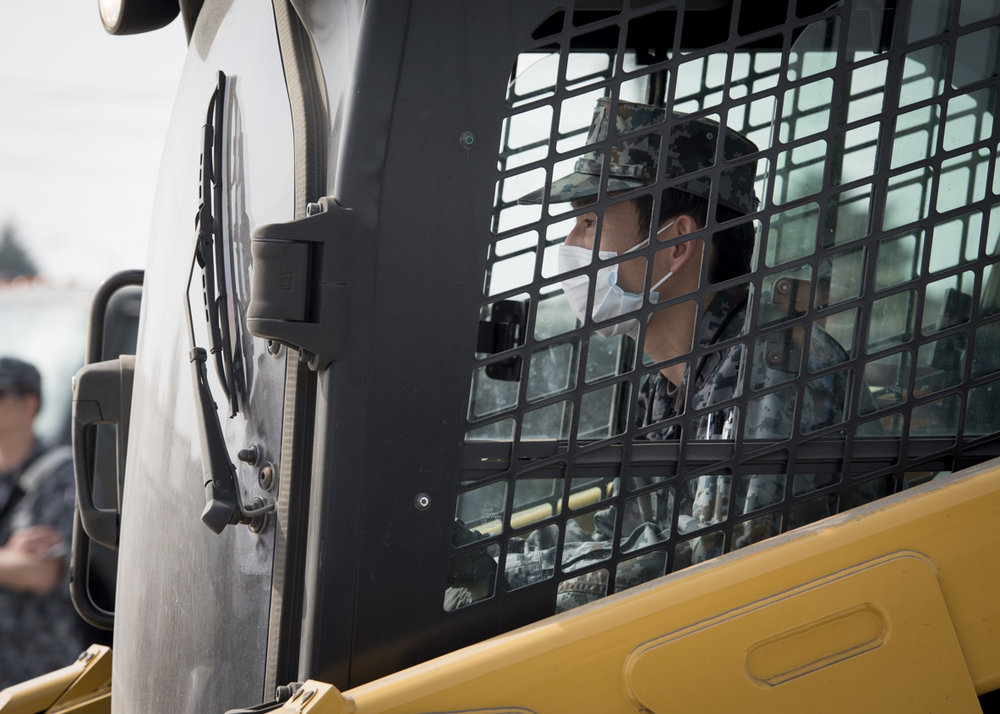 A Koku-Jieitai Airman operates equipment during a rapid airfield damage repair demonstration, Mar. 29, 2018, at Yokota Air Base, Japan. Airmen from the 374th Civil Engineering Squadron took the Koku-Jieitai engineers through a step by step process as they accessed damage, cut and removed the damaged section and replaced the area with new concrete. (U.S. Air Force photo by Airman 1st Class Juan Torres
