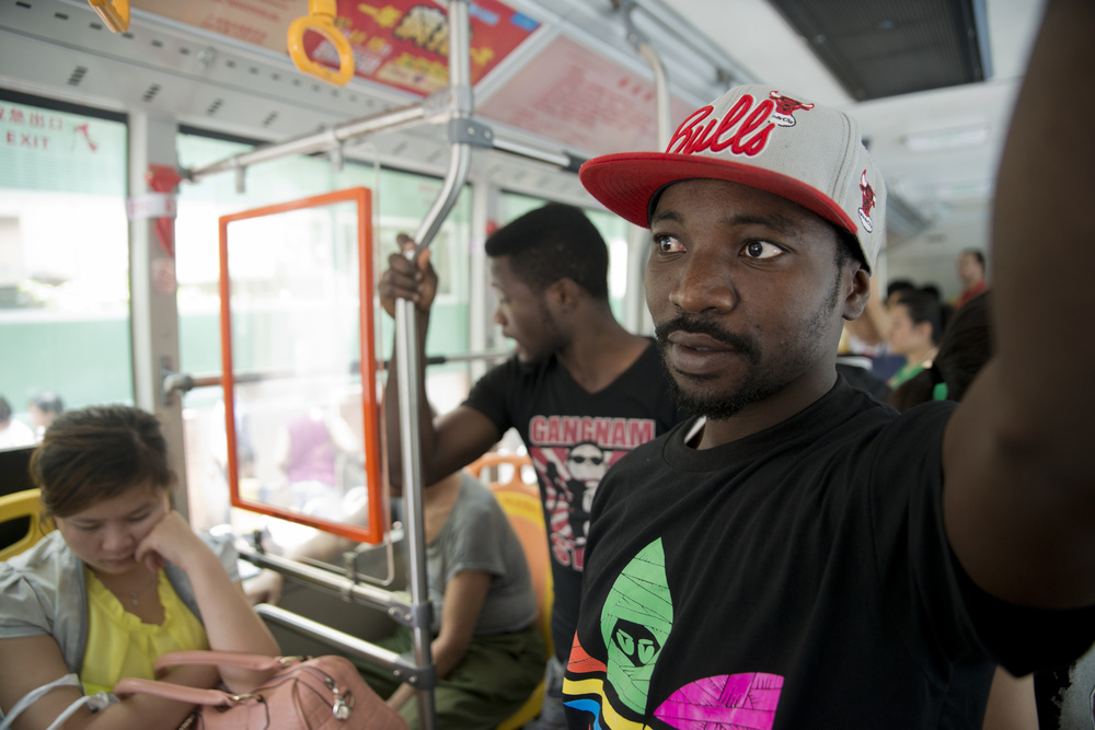 Alide and Yankuba take the bus for over an hour to the university. While riding on public transportation, Chinese glare, refusing to sit next to them on the subway or bus. The two brothers admit that while Xiao Bei is cramped and dirty, it offers somewhere for Africans to escape persistent reminders that they are black outsiders in China.
