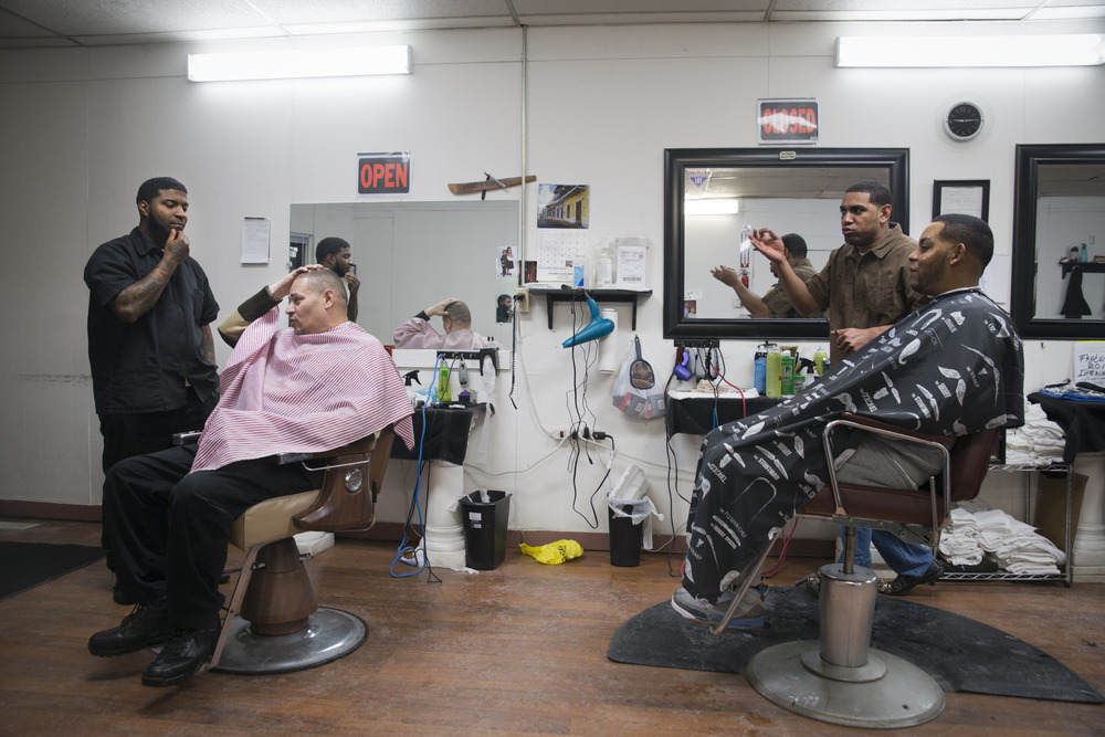 A popular gathering spot, the Borinquen barbershop serves the Spanish Westside community of Syracuse. Speaking primarily in Spanish, Green Eyes hangs out with barbers Pito and Rigo.