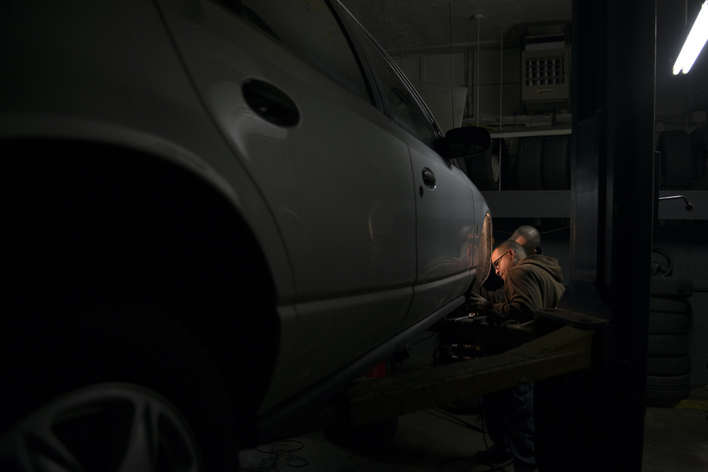 A mechanic by trade, Green Eyes and a friend change the tires on his wife's car, attempting to get everything fixed before he goes away.