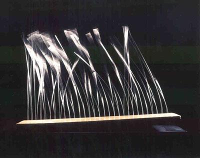 Len Lye, Grass, 1961, stainless steel wires, motor, wooden base, 2230 x 1580 x 20 mm. Collection of the Len Lye Foundation, Govett-Brewster Art Gallery / Len Lye Centre