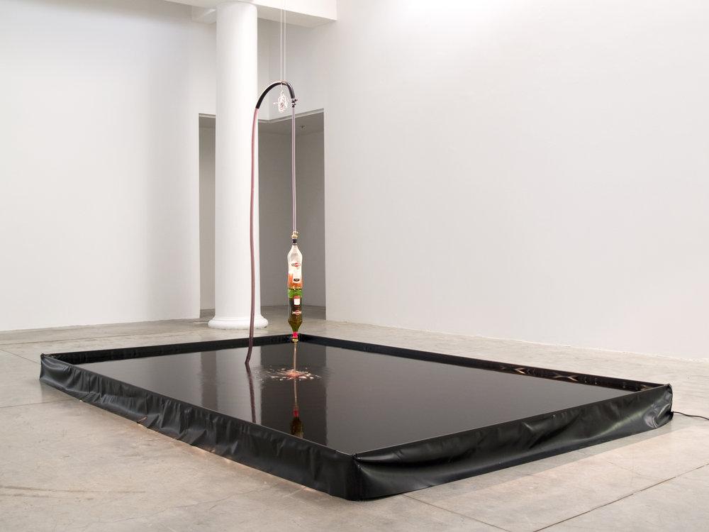 Alicia Frankovich,  Revolution (Martini Fountain)  2010, Martini Rosso, pool lining. tray, pump, piping, fixtures, silicon
