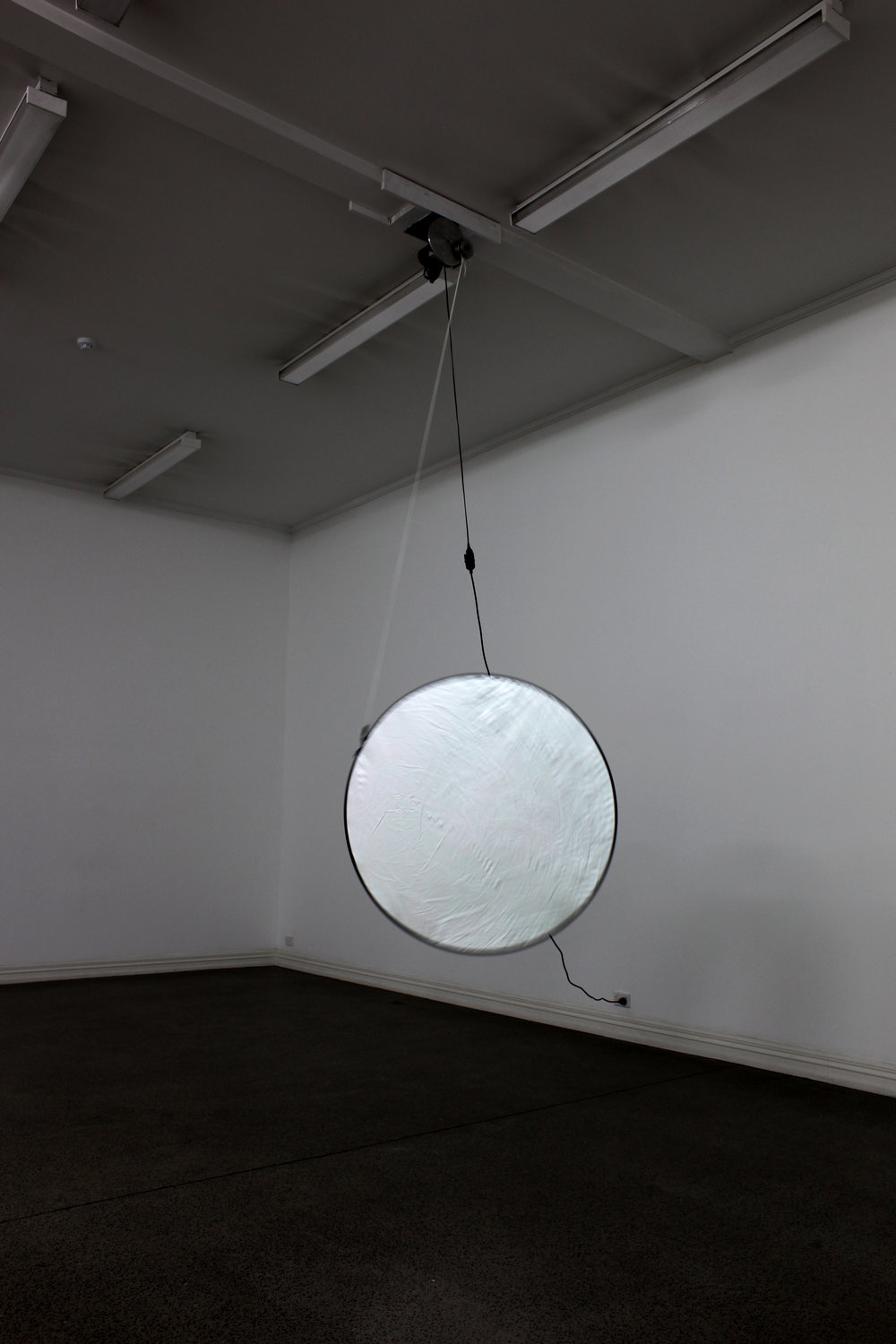 Alicia Frankovich,  Man Walked on the Moon  2011, engineered mechanism, photographic collector and cord, from the  Bodies and Situations  exhibition, Starkwhite, 2012