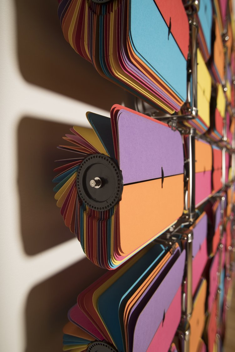 Rebecca Baumann,  Automated Colour Field (Variation 8) , 2017, (detail), 140 clock and archival colour card, 1290 x 5030 x 90 mm, edition of 3 plus a/p. Collection of the Museum of New Zealand Te Papa Tongarewa. Image courtesy of the artist and the Museum of New Zealand Te Papa Tongarewa. Photo: Maarten Holl