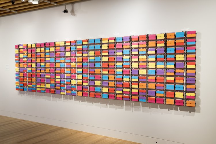 Rebecca Baumann,  Automated Colour Field (Variation 8) , 2017, 140 clock and archival colour card, 1290 x 5030 x 90 mm, edition of 3 plus a/p. Collection of the Museum of New Zealand Te Papa Tongarewa. Image courtesy of the artist and the Museum of New Zealand Te Papa Tongarewa. Photo: Maarten Holl