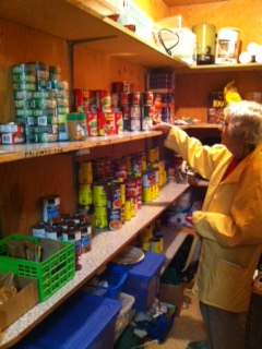 Volunteer Joy Huntley stocks the shelves