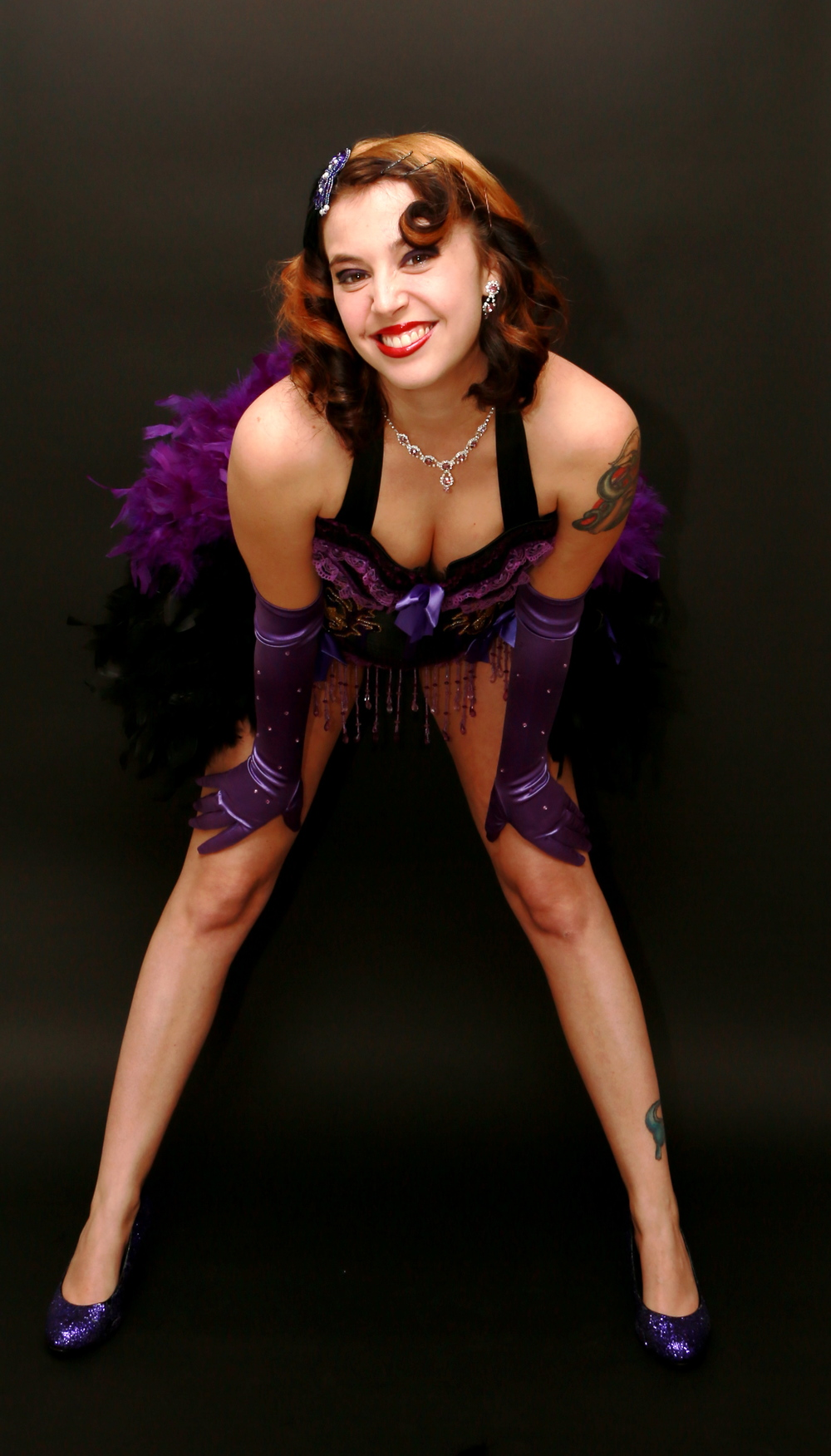 Lily Stitches - The Host and Veteran Performer of Ink & Paint Club Burlesque. Photo by Speckle Photo