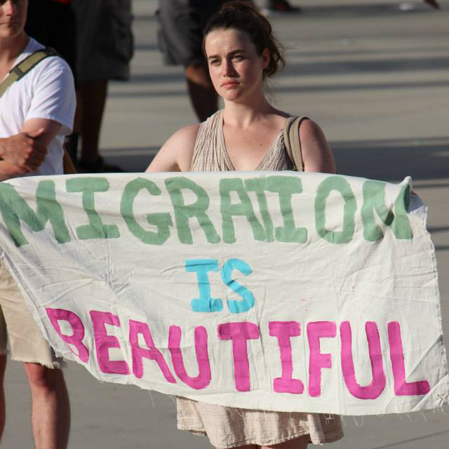 Lana Woodward marching on May 1, 2014 for Immigration Reform.  Photo:  Maria Blum-Sullivan