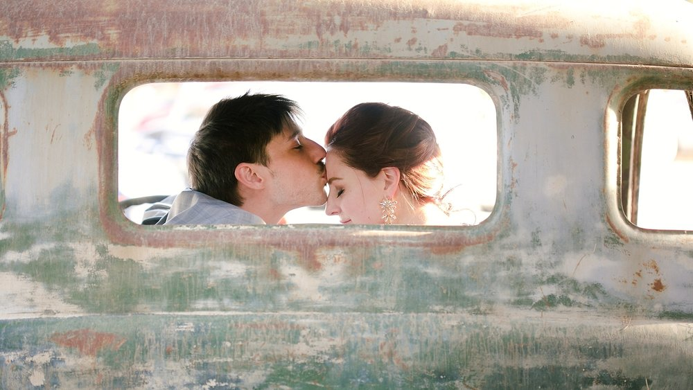 old-car-wedding-kiss