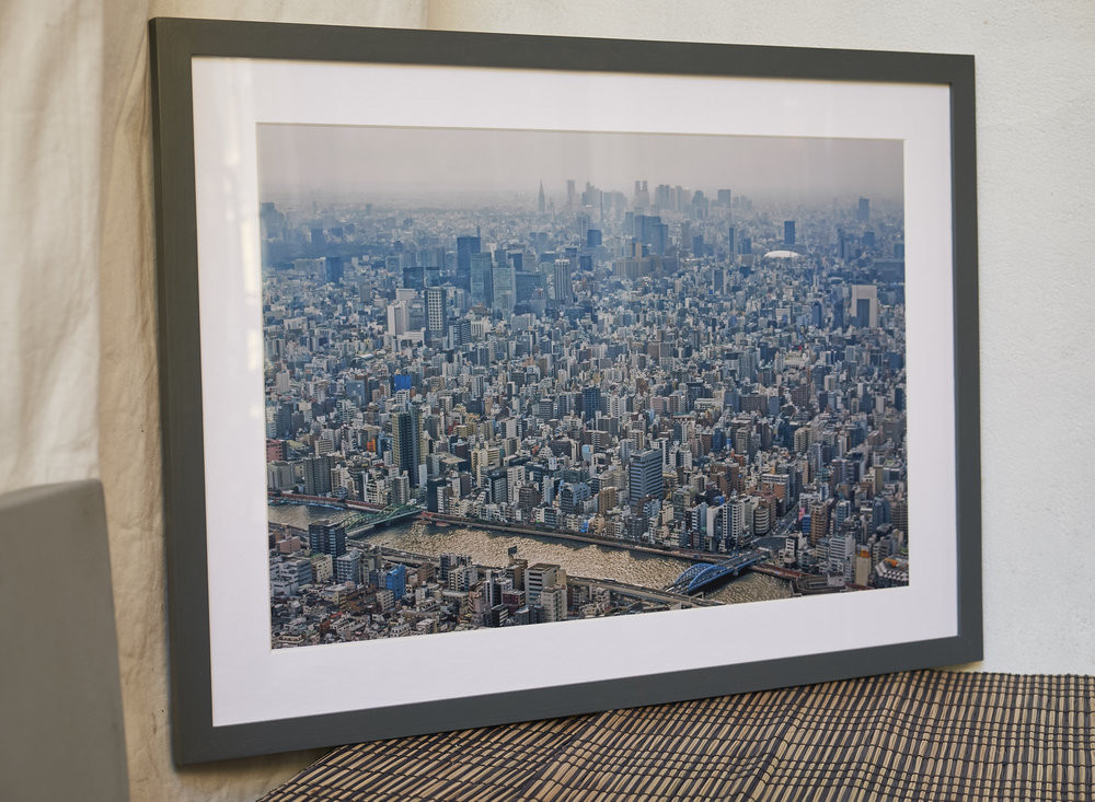 "Tokyo Microcosm A picture that makes you go wow! The sprawling metropolis of Tokyo, presented in a stylish dark grey frame. Could keep you entertained for hours! Frame Size approx 23 x 17"". COST £75.00"