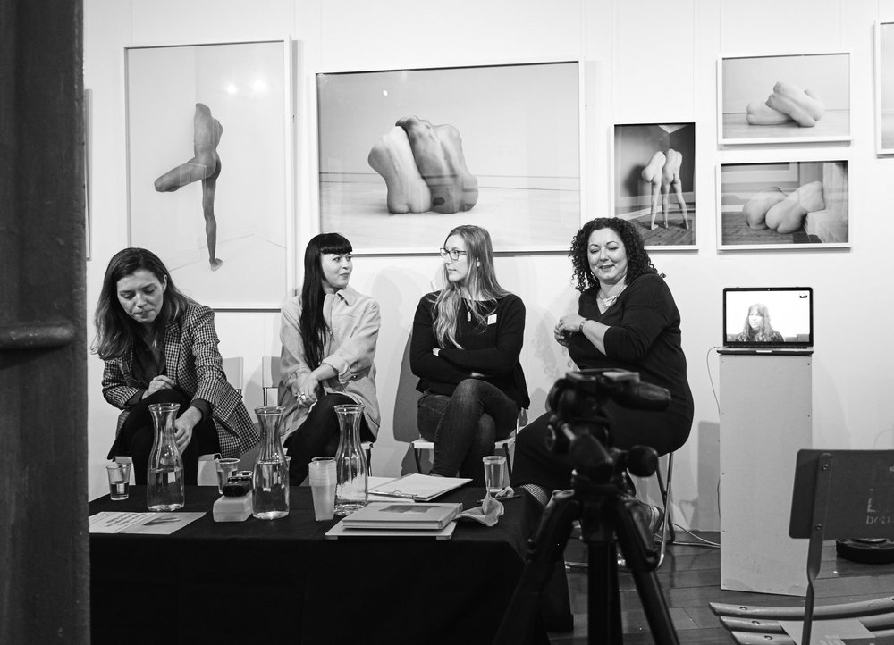 Symposium: Women FIX Photography. In the room:  Visible (l-r) Victoria from Christie's Auction room  Rhiannon Adam, Artist  Chloe Rosser, whose work Form and Function you can see on the walls  Laura Noble, Organiser  Not visible:  Del Barrett, Vice President of the RPS and founder of @100heroines  Karen Harvey, director of Shutter Hub  Renee Jacobs, Photo de Femmes, was skyped live from Florida when the floor was opened up for discussion!