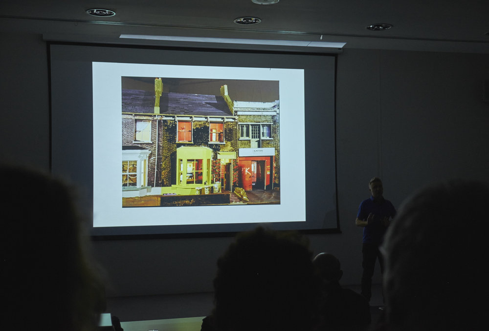 Tom Hunter talking about his degree project 'The Ghetto' when he made a complete model of the street he lived on as a squatting tenant.  The Ghetto  title was inspired by an article printed in the Hackney Gazette, giving a scathing report on the alternative community Tom knew and loved. His photographs and model formed part of a campaign to save the community from developers and Hackney Council. It was saved, and Tom still lives in the neighbourhood today.