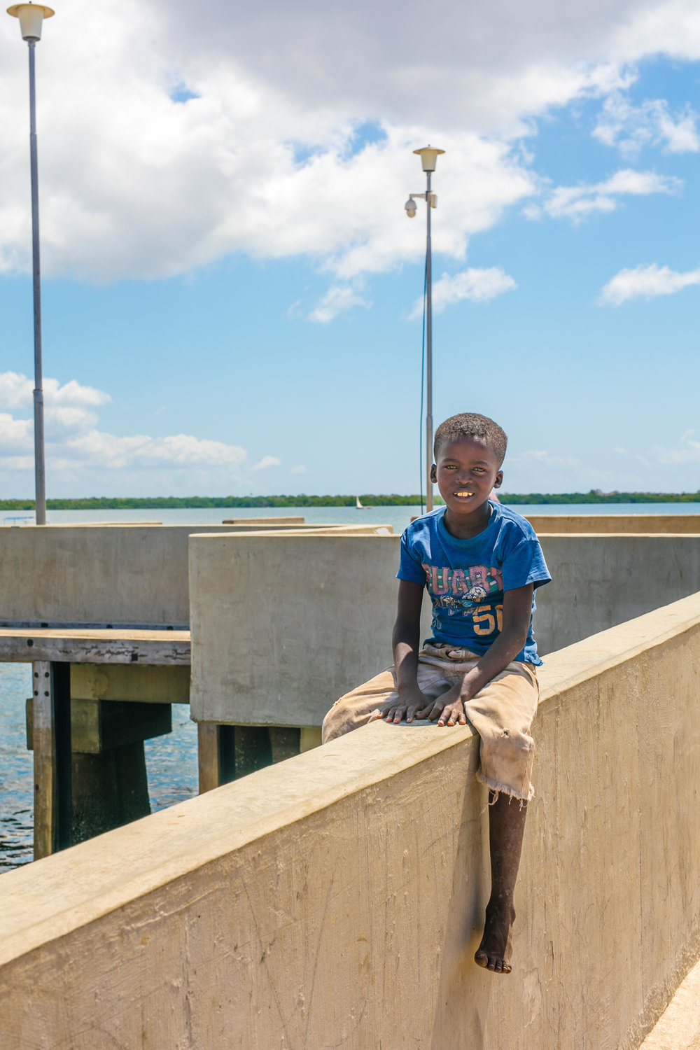 Little boy on the dock in Lamu Town