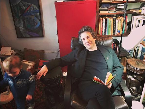 Neil Gaiman with his little boy, Ash. Photo: @amandapalmer