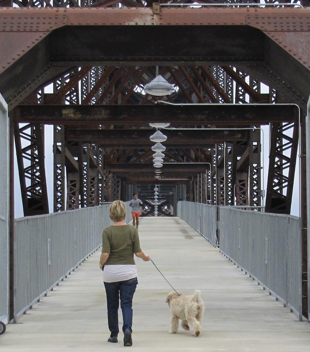 Kathy & Macy strolling down the bridge.jpg