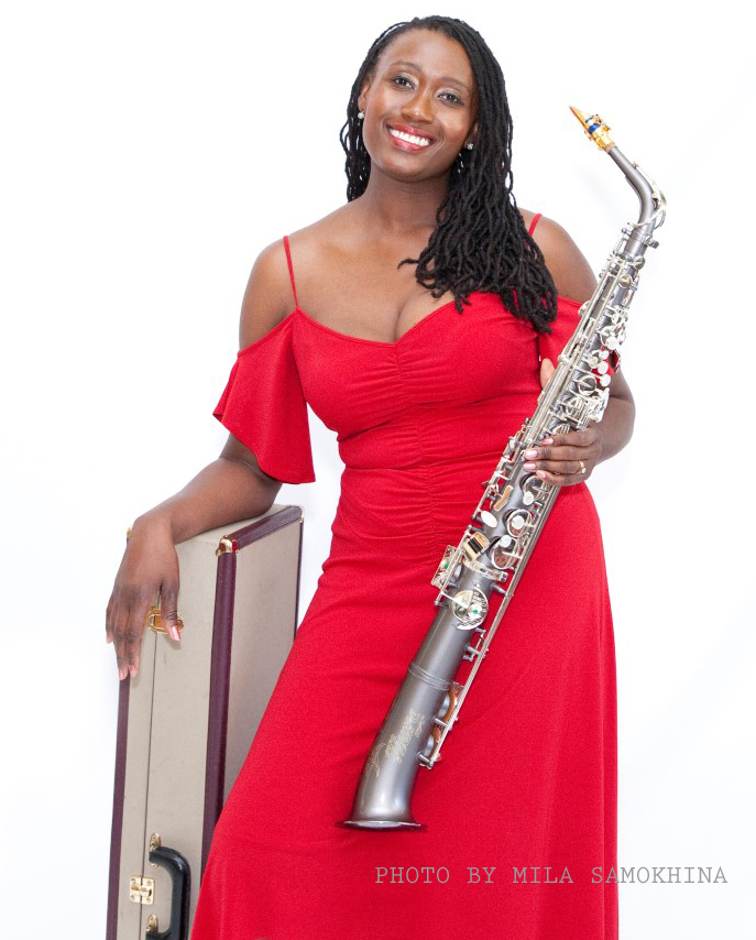 "A Chicago-born beauty, saxophonist, pianist and gifted songwriter who leads her own dynamic band.  As the youngest of seven, D-Erania grew up listening to her siblings play music by artists like Earth, Wind & Fire, Stevie Wonder and George Clinton. Yet, her earliest influence is her mother, who is a traditional gospel vocalist and musician. ""I have very fond memories of my Mother playing the piano or organ, and singing gospel songs to me as a child"", she says. ""I've been singing and playing piano by ear since the age of three."""