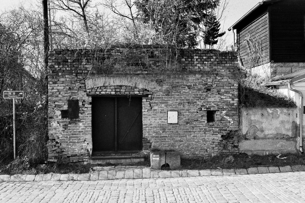 Black and white image of the entrance to a wine cellar