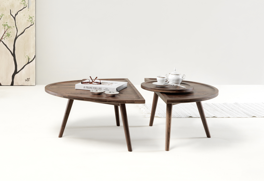COLOMBO IS COMPOSED BY TWO HALVES, WHICH CAN BE SEPARATED INTO TWO SIDE TABLES, EACH ONE DISTINCT BY ITSELF. READ MORE