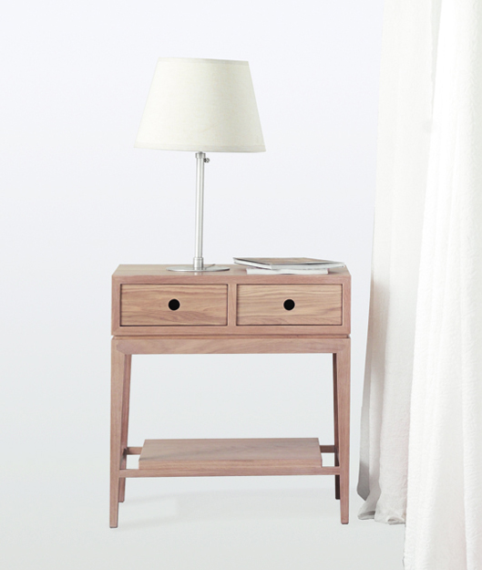 CRIADO MUDO IS A SIMPLE SIDE TABLE WITH TWO DRAWERS AND A STRETCHER SHELF WHICH ARE PERFECT TO STORE THE DAILY ESSENTIAL OBJECTS. READ MORE