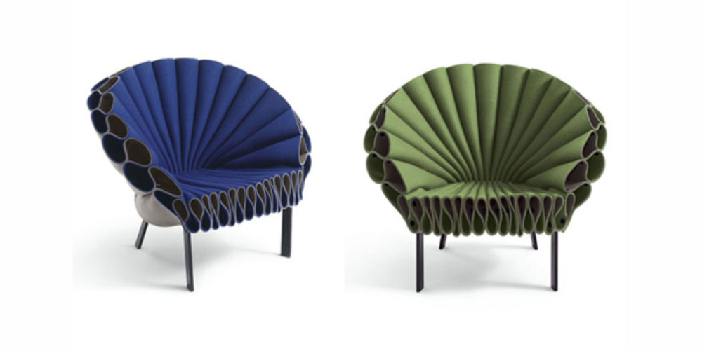 Peacock chair from Cappellini is constructed using three sheets of felt tightly bound together like pages in a book, fanning out to mimic peacock feathers in a three dimensional way.