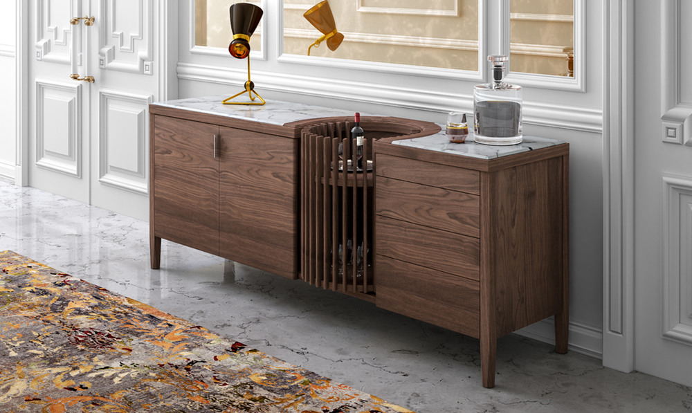CAROUSEL    CAROUSEL  is a refined and sophisticated sideboard with a unique design and luxutious materials.  CAROUSEL  features a solid walnut frame with a stunning marble top and a turntable in the middle for the bottles and glasses or for your favourite objects.   READ MORE