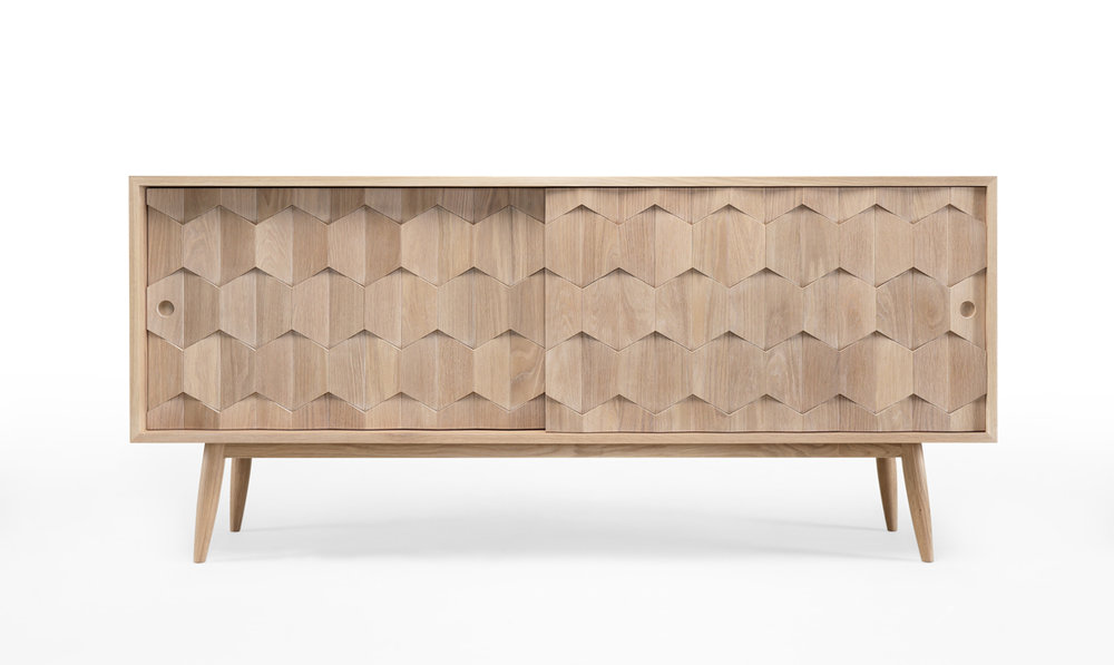 SCARPA is a mid-century modern sideboard structured bu solid oak which plays with texture, geometry and material.