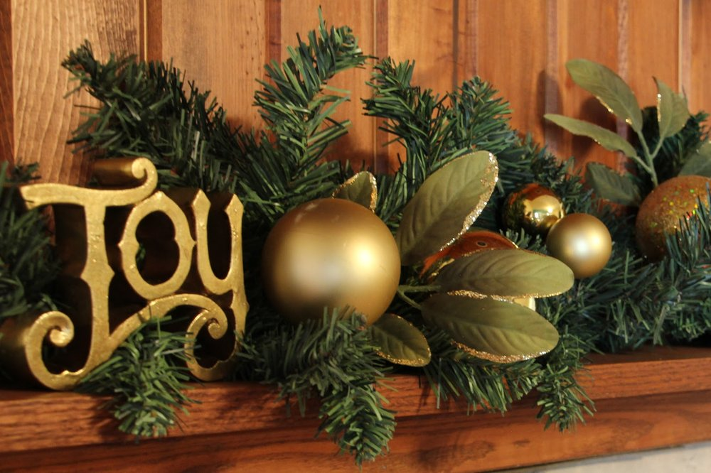 christmas-likable-fireplace-mantel-decoration-idea-for-christmas-with-gold-joy-display-text-and-shiny-gold-balls-and-leaves-also-green-pine-needles-37-wonderful-fireplace-mantel-decorations-for-christ.jpg