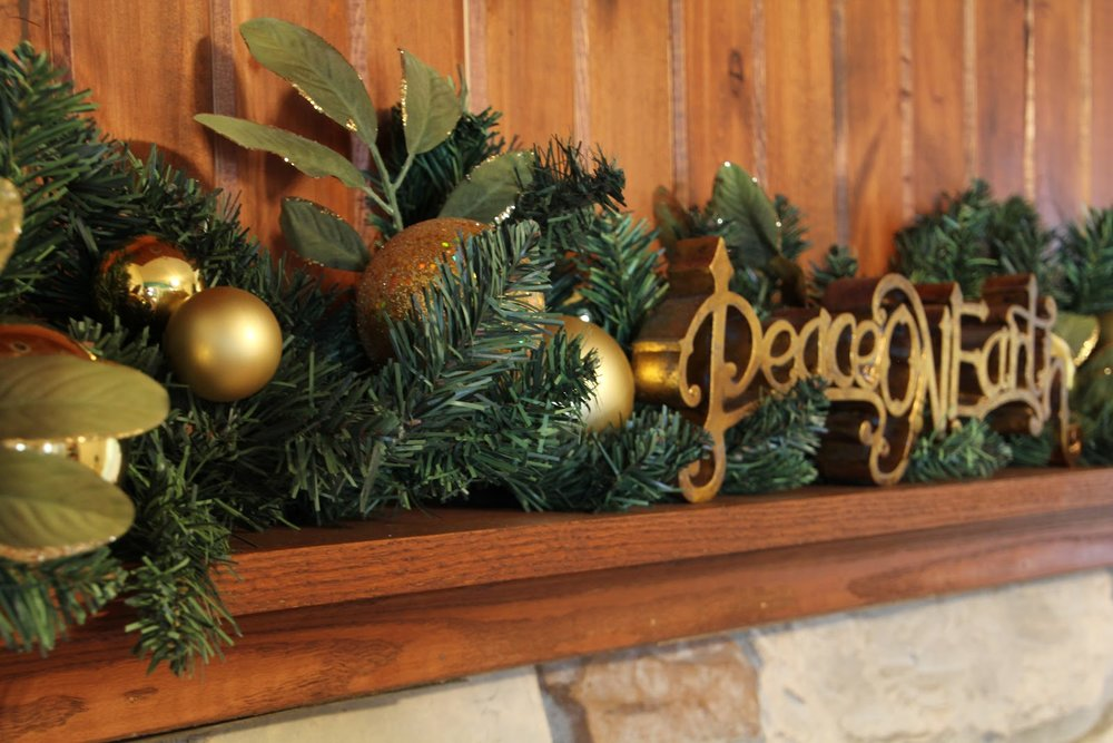 ideas-living-room-delightful-living-room-mantel-with-green-garland-along-with-golden-christmas-balls-and-wooden-mantel-shelf-christmas-themed-mantel-decorating-ideas-christmas-fireplace-decorations-a.JPG