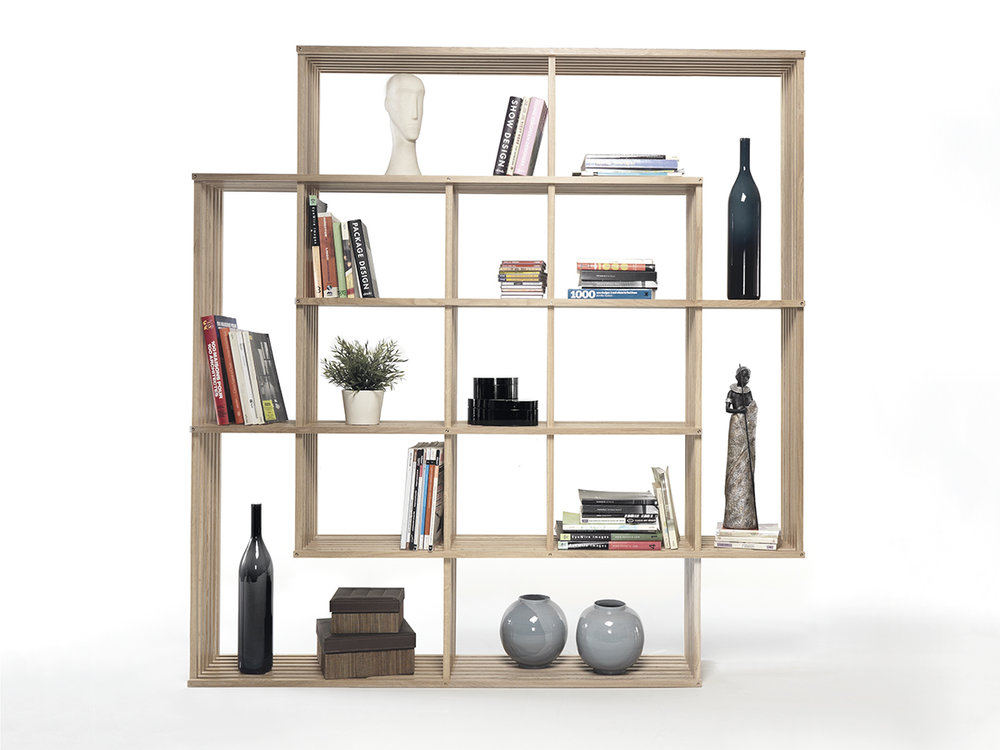 Bookshelf House fits hundreds of books into multifunctional ...