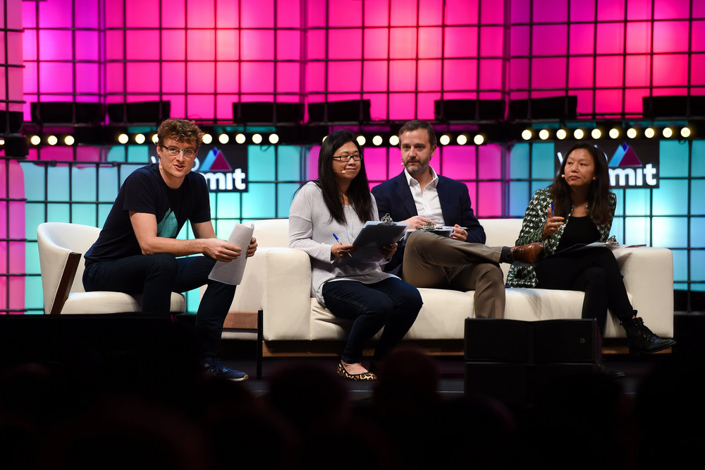 8 November 2018; From left, Paddy  Cosgrave, CEO, Web Summit, Holly Liu, Visitng Partner, Y Combinator, Tom  Stafford, Managing Partner, DST Global, and Bedy Yang, Managing  Partner, 500 Startups, judging the Pitch Final on Centre Stage during  day three of Web Summit 2018 at the Altice Arena in Lisbon, Portugal.  Photo by Diarmuid Greene/Web Summit via Sportsfile