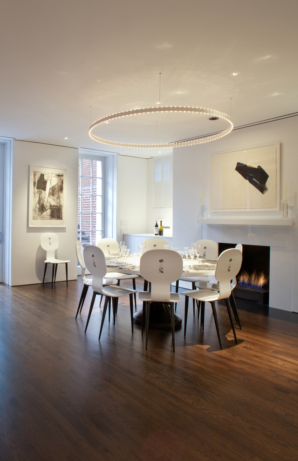 "Dining room with Jacobsen ""Halo"" light."