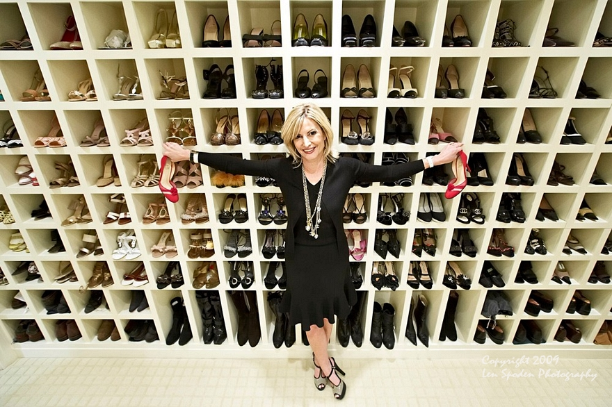 A library of shoes and a happy client.