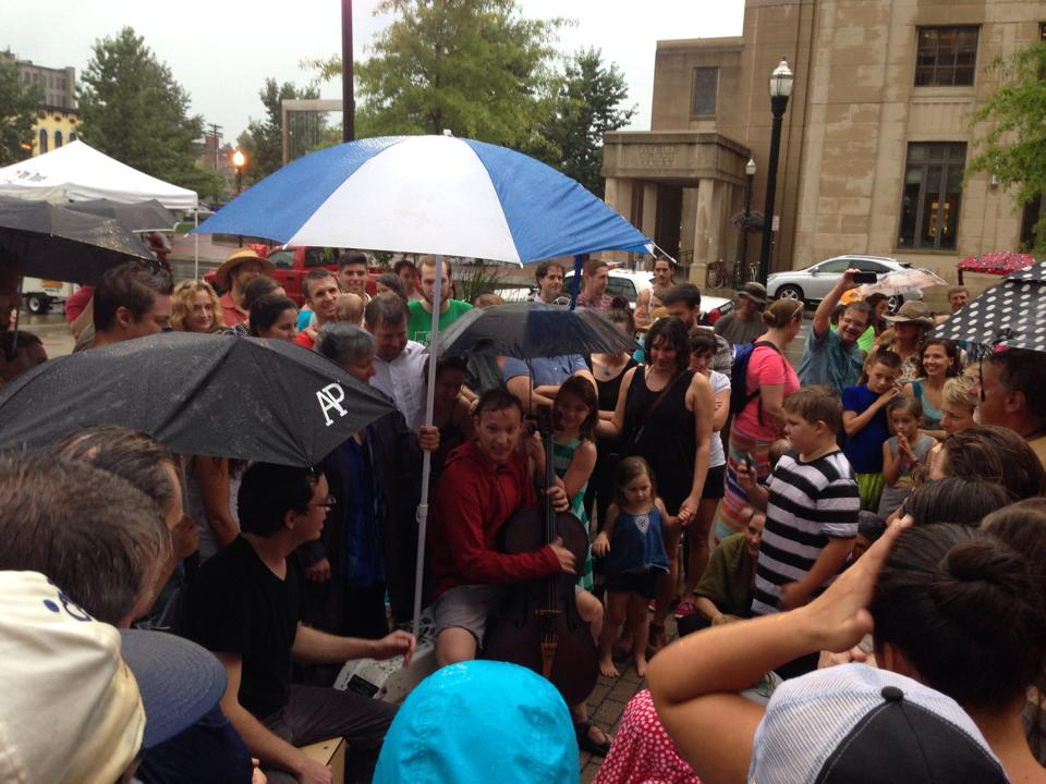 It may have rained during Ben and Jordon Ellis' performance for Phoenix Fridays in Lexington this past summer, but that didn't stop them from playing and the folks from listenin'! (photo by Kyle Snyder, August 2014.)