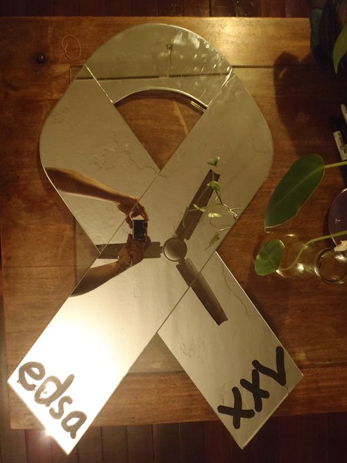 a mirror cut in the shape of a ribbon
